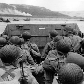 American assault troops move onto a beach in Normandy France, on D-Day - D-Day Landings in Normandy