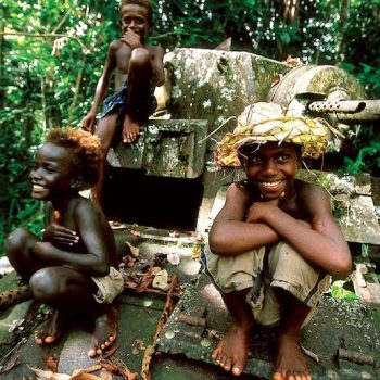 Solomon Islands kids on Pacific War tank - Guadalcanal and HMAS Canberra Anniversary Tour