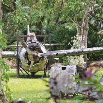 Wreckage of American Grumman Wildcat fighter plane in outdoor Vilu War Museum, Guadalcanal, Solomon - Guadalcanal and HMAS Canberra Anniversary Tour
