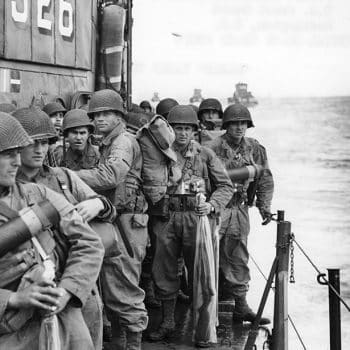 American soldiers onboard a ship approaching the coast of Normandy - Normandy D-Day Tour