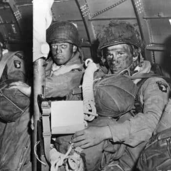 Members of the the 506th Parachute Infantry Regiment, 101st Airborne, prepare for takeoff on D-day - Normandy D-Day Tour